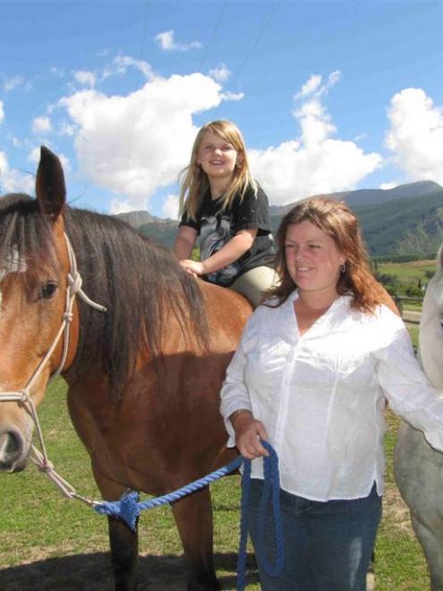 Vicki Bonham-Hoskin, with daughter Rebekah (7), has her hands full keeping the Spirit of Equus...