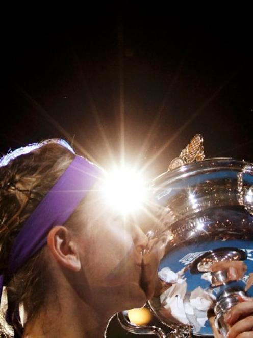 Victoria Azarenka of Belarus poses with the Daphne Akhurst Memorial Cup after defeating Li Na of...