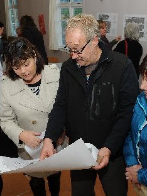 Victoria Rd residents (from left) Steve Hunt, Liz and Rene Lammers and Sue Hunt examine a drawing...