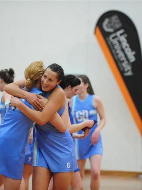 Villa Maria College goal shoot Grace Prendergast (left) and goal keep Joanna Trip share a hug to...