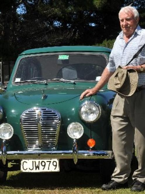Vintage Austin Register member John Gertson stands in the sun with his 1955 A30 Austin at Music...