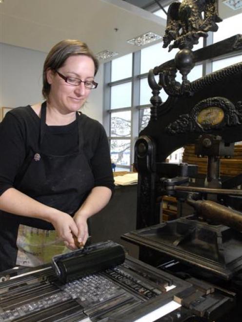 Visiting Australian craft printer Caren Florance inks up type on an old Columbian press at the...