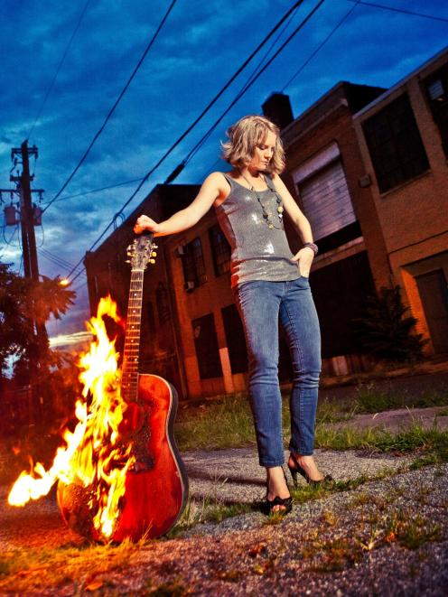 Visiting United States musician Melissa Cox, who plays songs with Celtic flair and uses live...