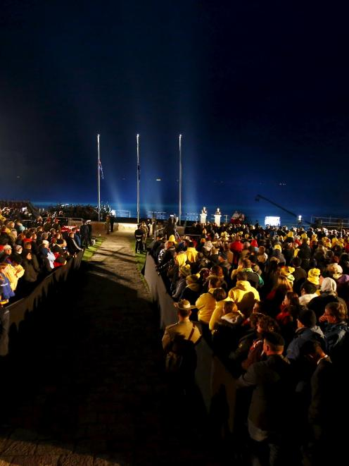 Visitors from Australia and New Zealand attend a dawn ceremony marking the 100th anniversary of...