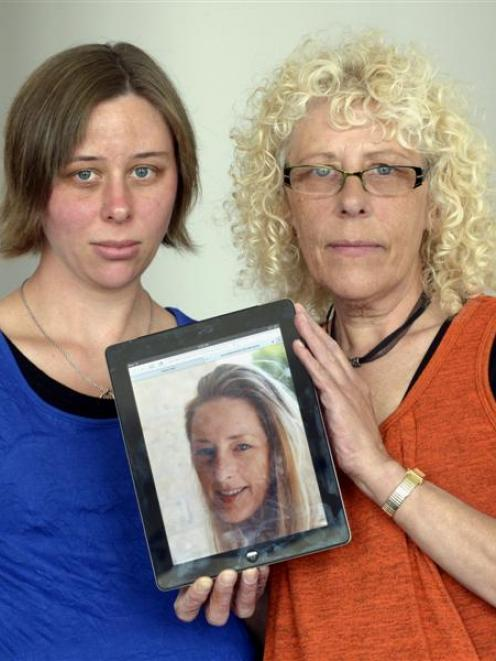 Vivien McKenzie and her daughter Kylie Maloney, both of Dunedin,  hold a picture of their late...