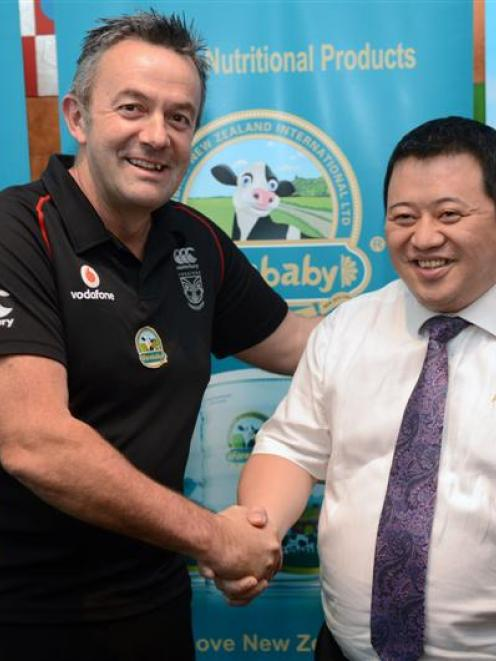 Vodafone Warriors chief executive Wayne Scurrah (left) shakes hands with Fernbaby managing...