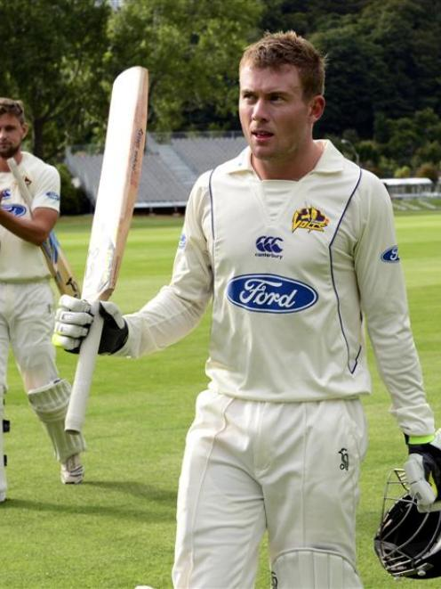 Volts batsman Nick Beard receives applause from team-mate Sam Wells as he leaves the field after...