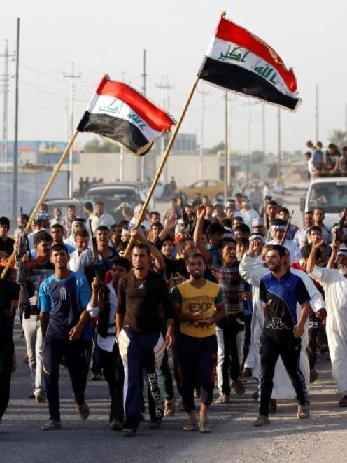 Volunteers who have joined the Iraqi Army to fight militants from the radical Islamic State of...