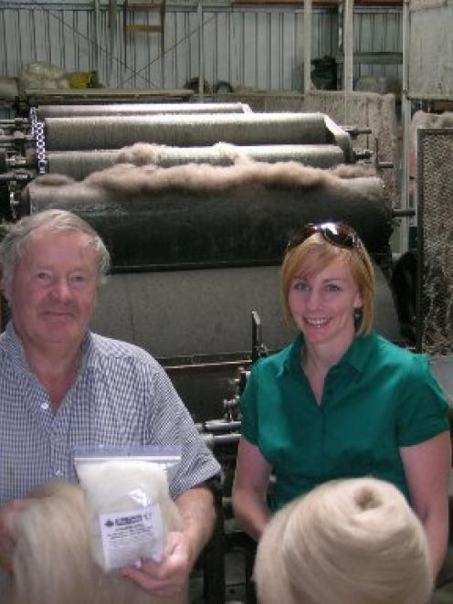 Belex Wool's former owner, Geoff Taylor, of Luggate, and operations officer Deirdre Coker, of...