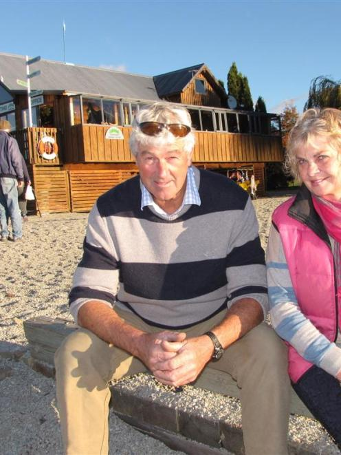 Simon and Danni Stewart say if Wanaka's distinctive ''log cabin'' (at rear) is removed from the...