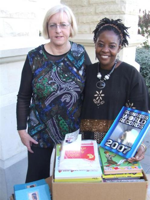Waitaki Boys High School librarian Hilary Bishop (left) and Getrude Matshe display some of the...
