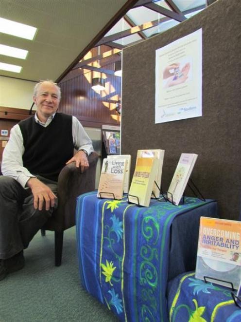 Waitaki district library manager Philip Van Zijl with some of the Oamaru Public Library's...