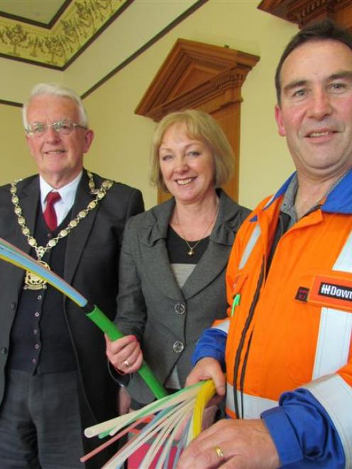 Waitaki MP Jacqui Dean and Downer civil works manager Stephen Christos get to grips with the...