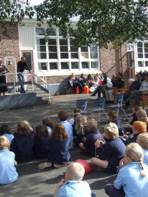 Waitaki Valley School pupils listen to board of trustees chairman John Watherston speak at a...