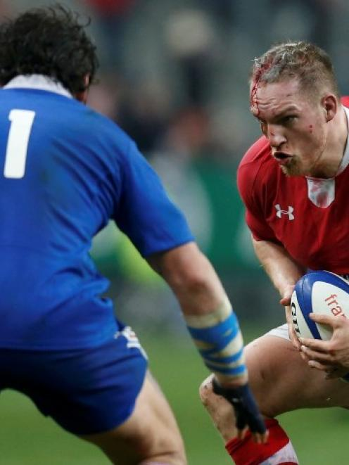 Wales Andrew Coombs (R) looks for a way past France's Yannick Forestier during their Six Nations...
