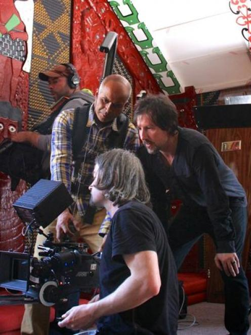 Wanaka film-maker Darren Simmonds (second from right) and crew members work behind the camera...