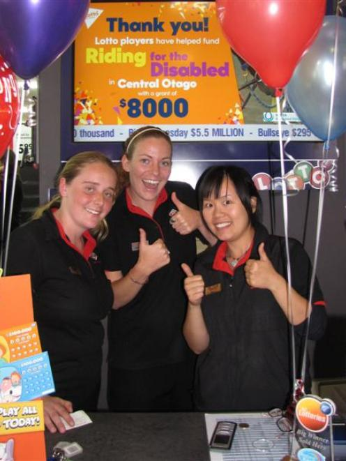 Wanaka New World Lotto staff (from left) Natasha Yeo, Melissa Foss and Shelly Chou wait for...