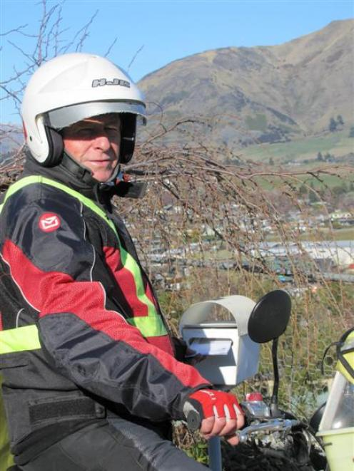 Wanaka postie Ed King finishes with NZ Post on Friday after 40 years. Photo by Mark Price.
