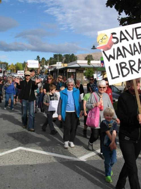 Wanaka residents march in support of maintaining the town's library services. Photos by Mark Price.