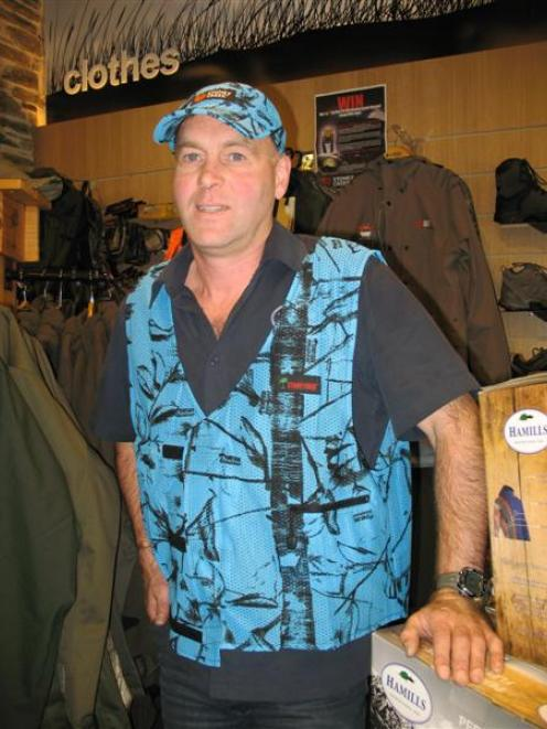 Wanaka retailer Mark Sanders models his 'blaze blue' hunting range in his shop on Thursday. Photo...
