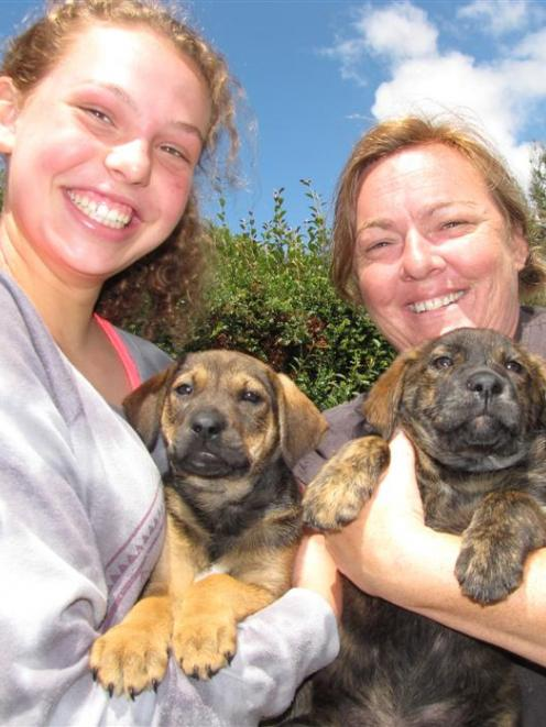 Wanaka's new animal shelter, run by Buffy Paterson (right) with help from volunteers like Callie...