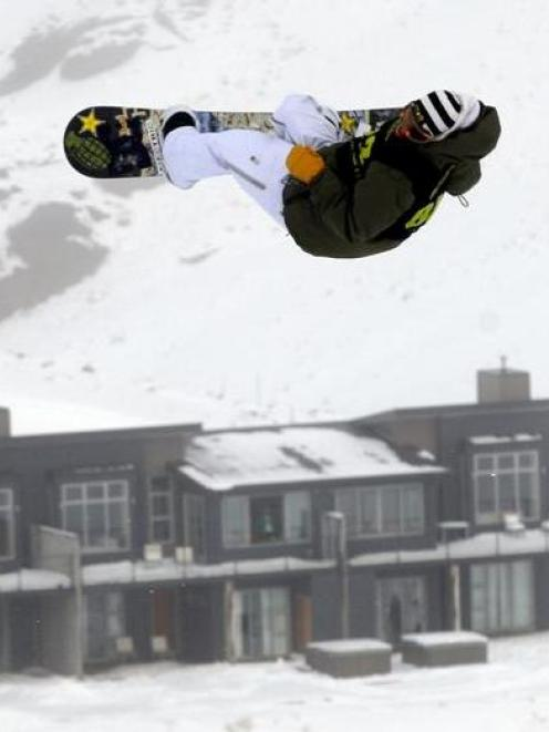 A snowboarder soars above Wanaka's Snow Park. Photo by NZPA.