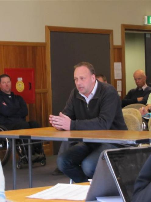 Wanaka Swim Club president Richard Fairbairn speaks at yesterday's Queenstown Lakes District...