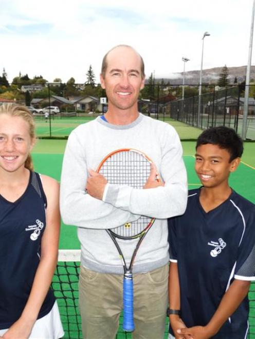 Wanaka Tennis Club coach Perry Crockett celebrates 10 years in the role with young proteges Ines...