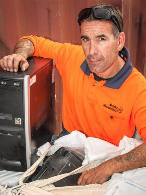 Wanaka Wastebusters guardian Matt Plant with some of the electronic waste saved from the landfill...