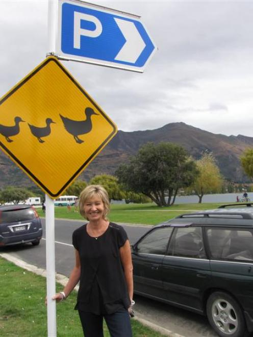 Wanaka woman Karen Neilsen with one of the resort's new lakefront ''ducks crossing'' signs for...