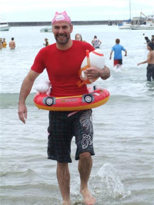 Warren Duncan braved the cold water at Friendly Bay yesterday to take part in Oamaru's annual...