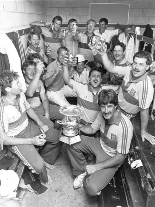 Warren Lees (holding trophy) and the Otago team celebrate winning the Shell Cup.