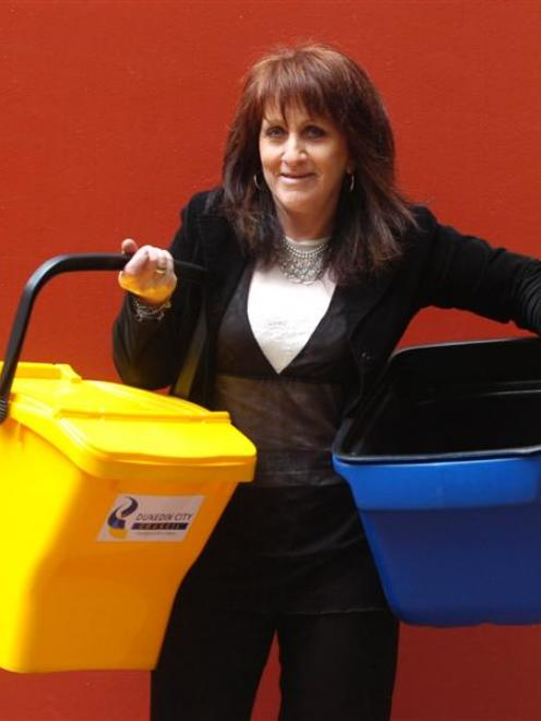 Water and Waste Services business support leader Narelle Barbour shows the proposed new  yellow,...