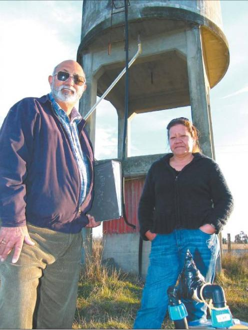 Water supply group member Ernest Johnston and Arowhenua Marae manager Mandy Home by the existing...
