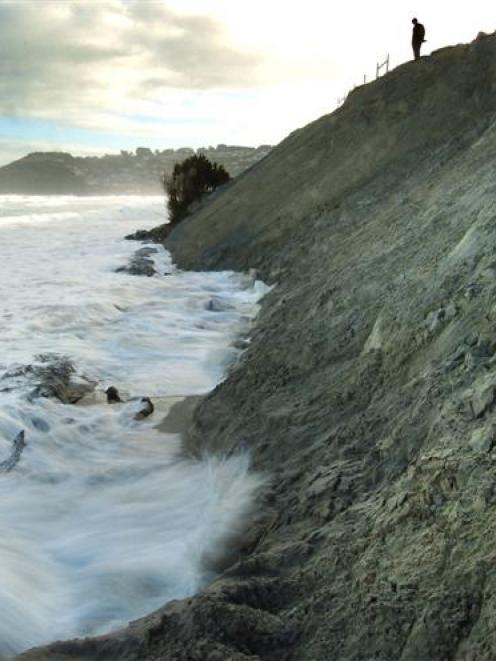 Waves begin eating away at recently dumped sand at Middle beach as the tide rises last month....