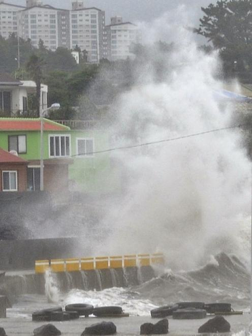 Waves crash as Typhoon Neoguri approaches the village in Seogwipo on Jeju Island. Photo by Reuters