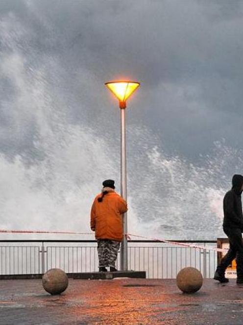 Waves pound the sea wall at St Clair beach in Dunedin. Photo ODT files