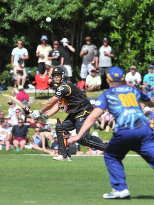 Wellington batsman Jesse Ryder plays uppishly as Nick Beard positions himself for an unsuccessful...