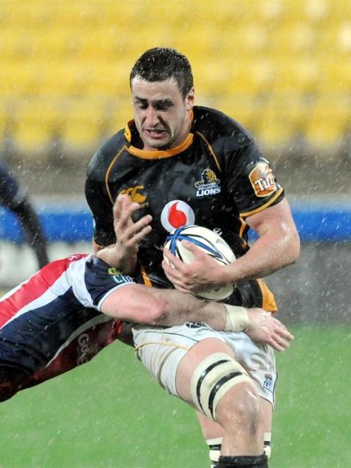 Wellington's Daniel Ramsay is tackled by Tasman's Steve Alfed in the ITM interprovincial rugby...