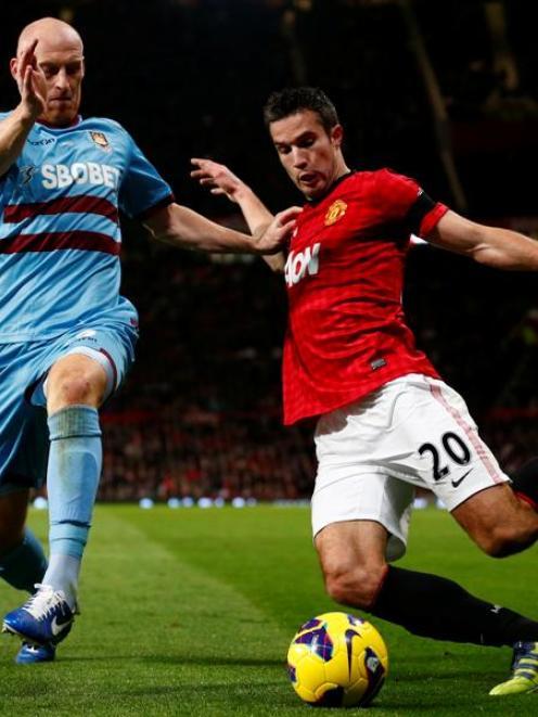 West Ham United's James Collins challenges Manchester United's Robin van Persie.   REUTERS/Darren...