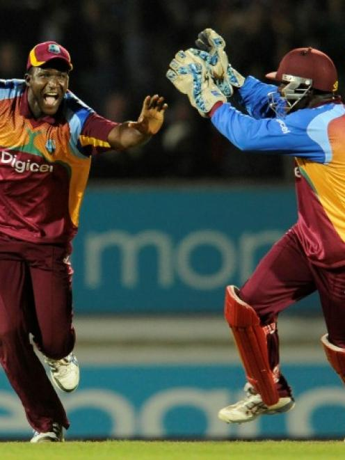 West Indies captain Darren Sammy celebrates with Derwin Christian after the West Indies won the...
