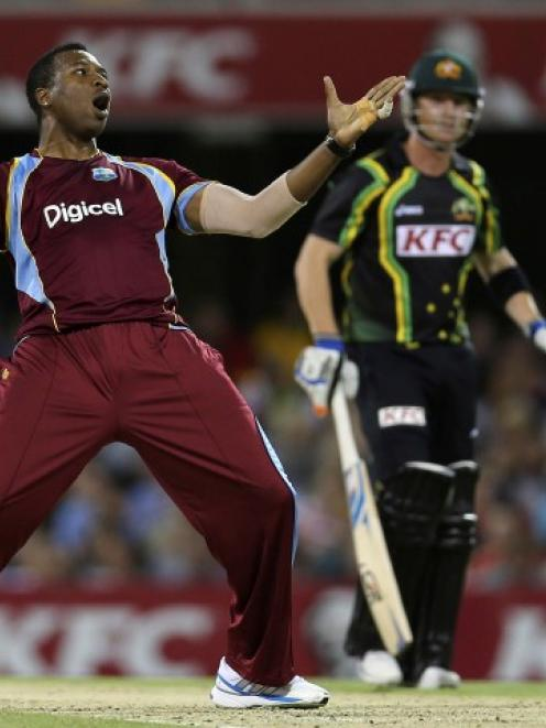 West Indies' Kieron Pollard celebrates the dismissal of Australia's Brad Haddin during their...