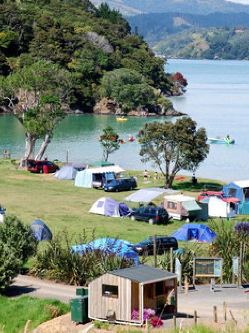 Whangaruru is a popular site for camping, pictured here is the DoC campsite. File photo / DoC