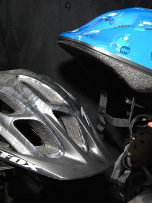 Whether they cost $219 (left) or $59, cycle helmets in New Zealand are required to meet only a...