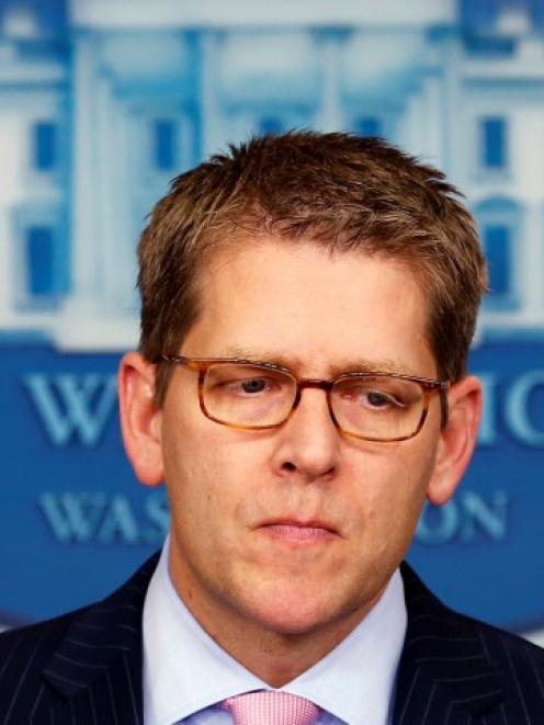 White House Press Secretary Jay Carney pauses as he speaks about US President Barack Obama's...