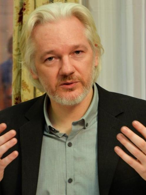 WikiLeaks founder Julian Assange gestures during a news conference at the Ecuadorian embassy in...