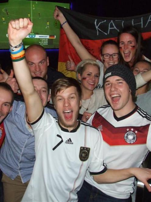 German supporters at Queenstown's Xtreme bar celebrate another goal during their nation's 7-1...