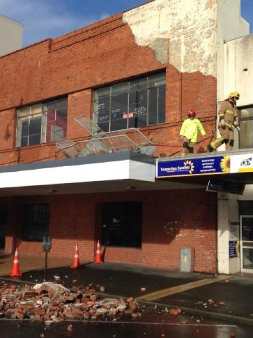 Wild weather was blamed for the collapse of part of this building facade on Tay St in...