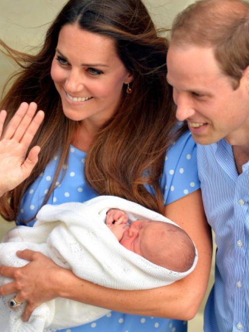 William and Kate are bringing baby George to New Zealand and Australia in April.  (Photo by John...