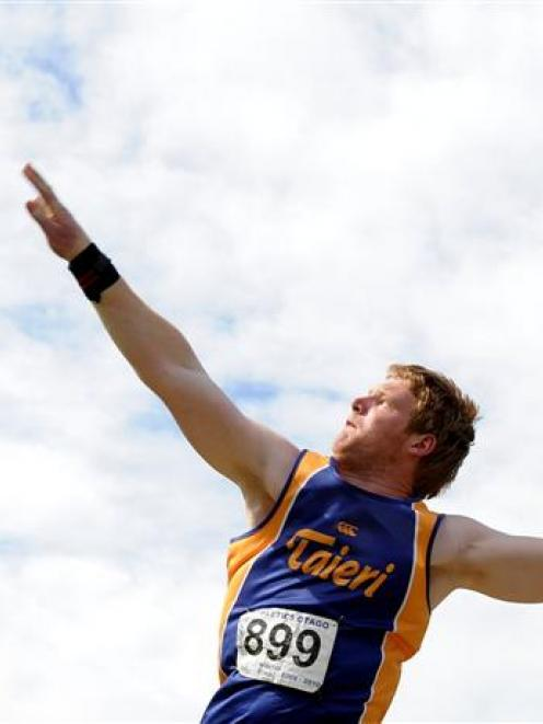 William Hubber on his way to winning the junior men's shot put at the Otago championships at the...